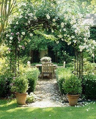 trellis, arbor, climbing roses, boxwoods, terracotta, gravel path, teak dining, outdoor patio, pea gravel