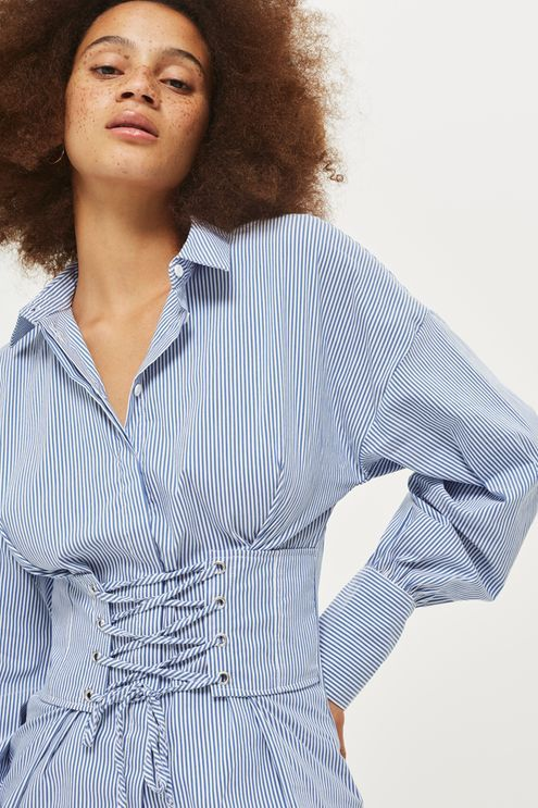 In stylish blue and white stripes, this cotton-blend shirt is reworked with a directional corset design at the front. We think it's great for keeping your wardrobe fashion-forward.