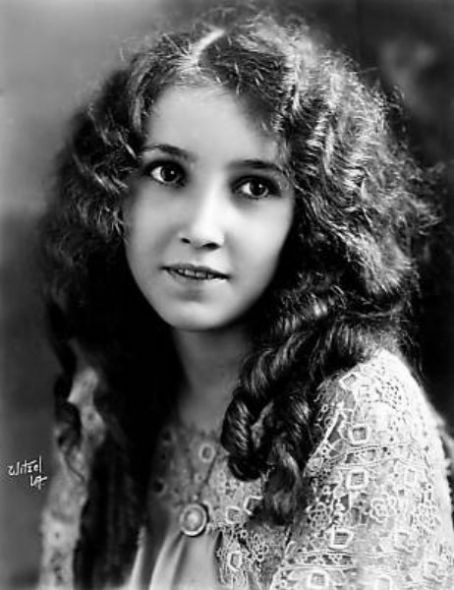 Bessie Love, silent film star 1920's. I would say that she could win a beauty contest with Anita Page. Anita Page is very pretty but Bessie is much prettier!! I think it is in the eyes.