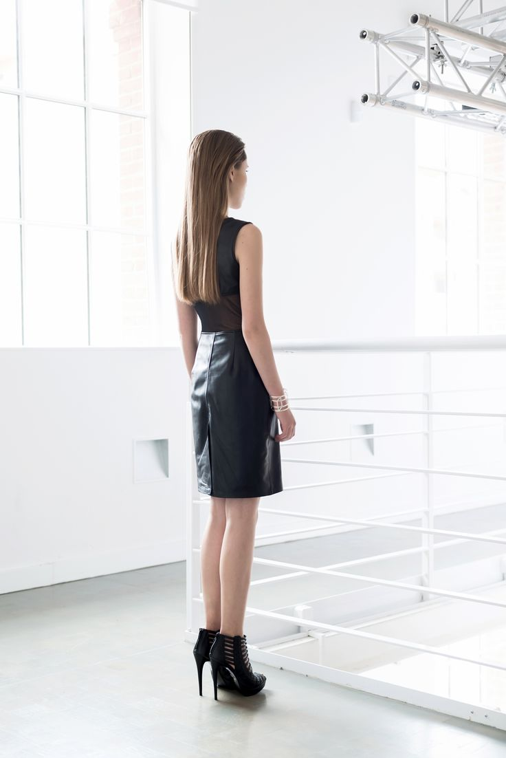 Leather skirt D066. An elegant leather dress which gives every stylization strength and femininity underlined by a tulle element which uncovers the fragment of the back.