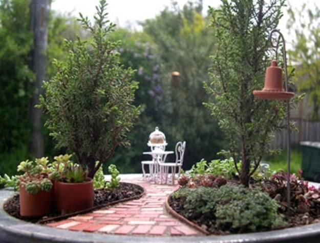 Miniature garden designs and fairy gardens.  This one looks like a courtyard.