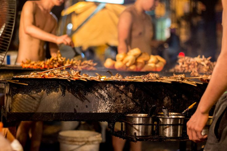 Chicken on the grill in Hanoi. Chicken Street is a must visit when in the city for a unique meal away from the crowds of the Old Quarter. #gosquab #hanoi #vietnam #food #travel