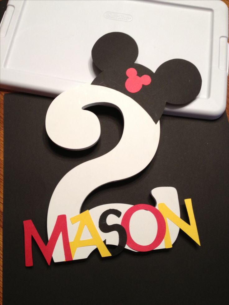 DIY...Mickey Mouse birthday decoration. The number is from a local craft store. I cut out the letters using a cricut and the Mickey's using a google images template.