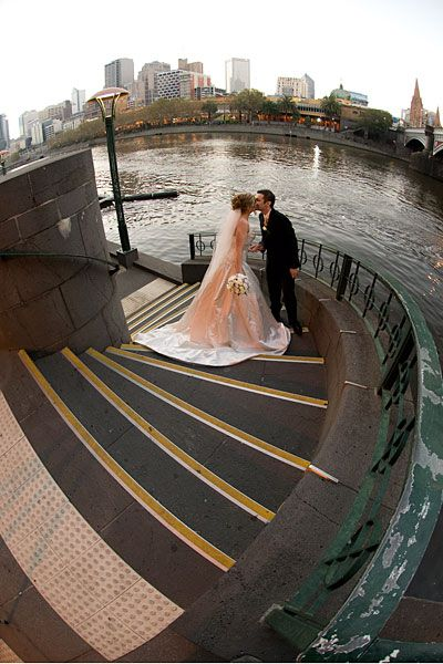 Wedding Photography Melbourne Southbank - showing a Bride and Groom on the Steps leading down to the Yarra River.