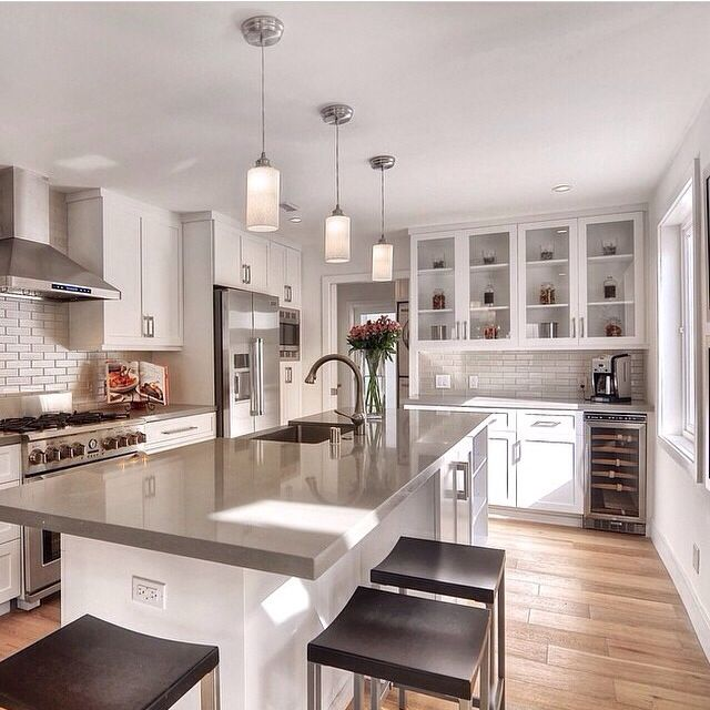 light grey countertops with white cabinets