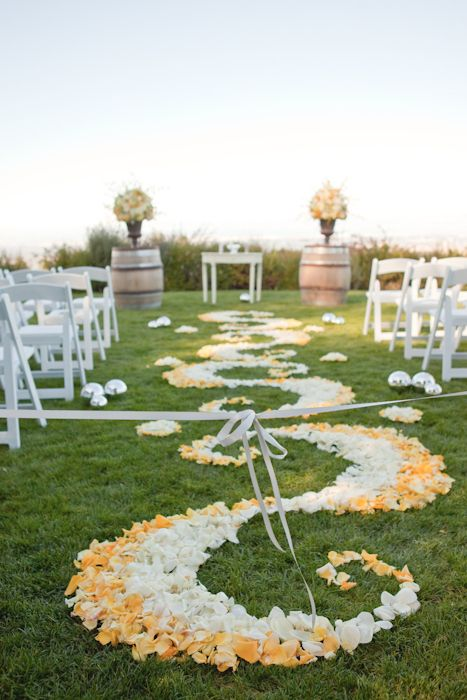 Alter with wine barrels on each side, and a beautiful trail of flower petals to lead the way. #weddingceremony
