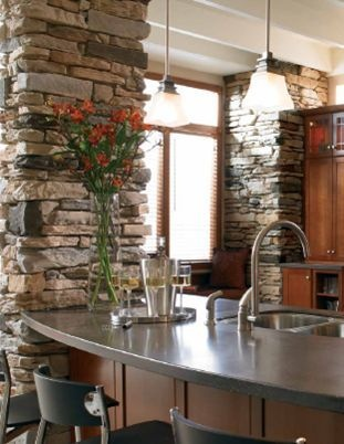 Pretty stone accent walls in the kitchen. Idea for the brick beams in dining and living room