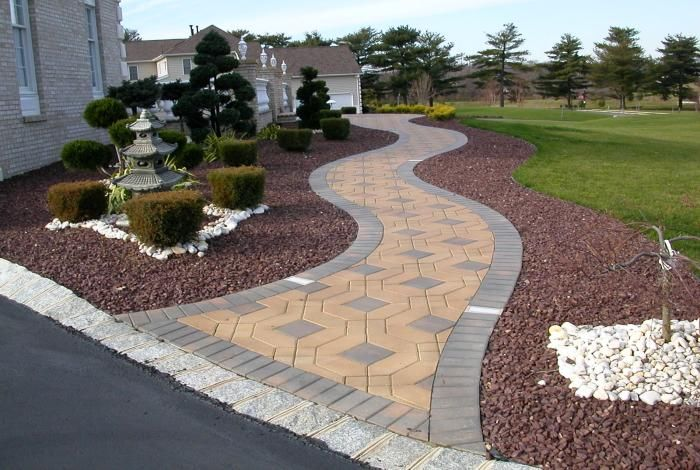 Pictures of paver walkways up to front doors front yard for Walkway landscaping