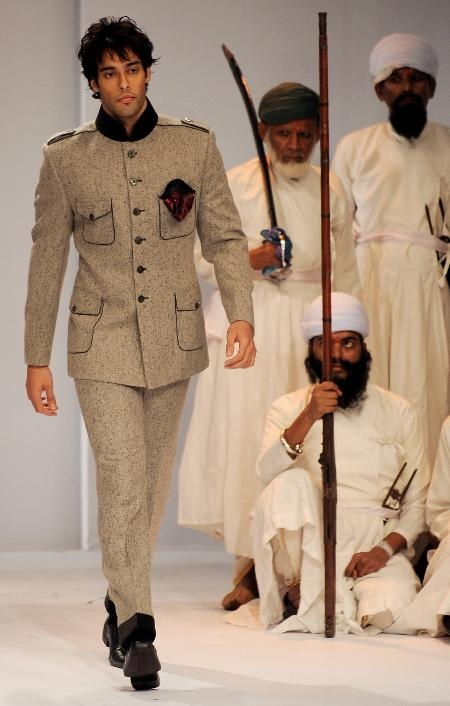 An Indian model present a creation by designer Himmat Singh during the Van Huesen India Men's Fashion Week