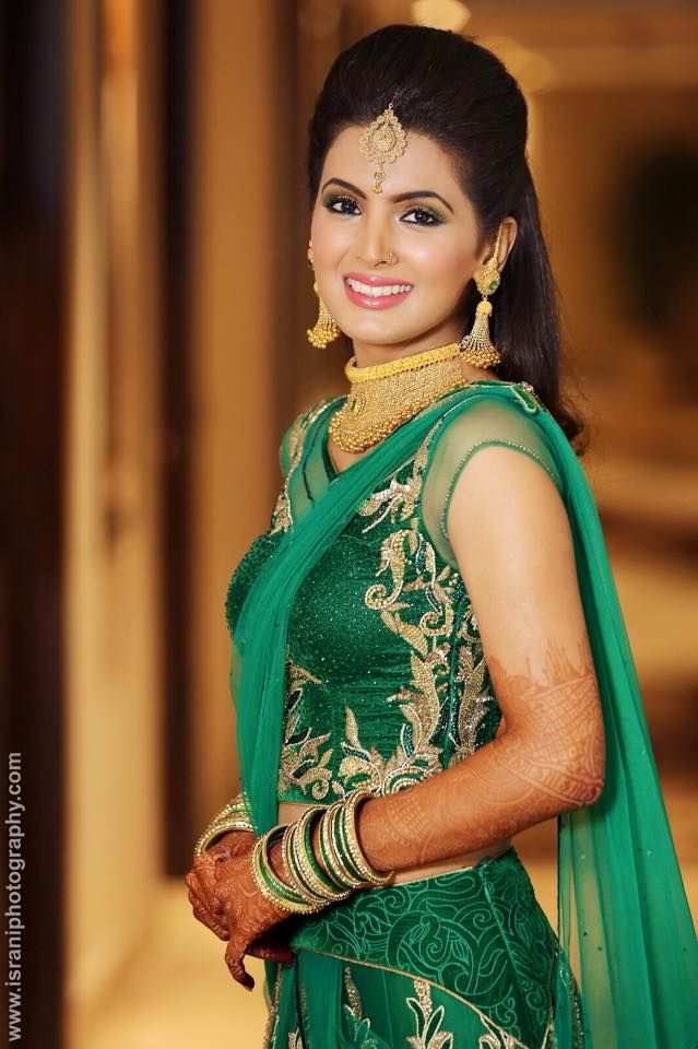 Bride Geeta Basra in a Dark Green and Gold Lehenga, Traditional Gold Jewelry on her Sangeet
