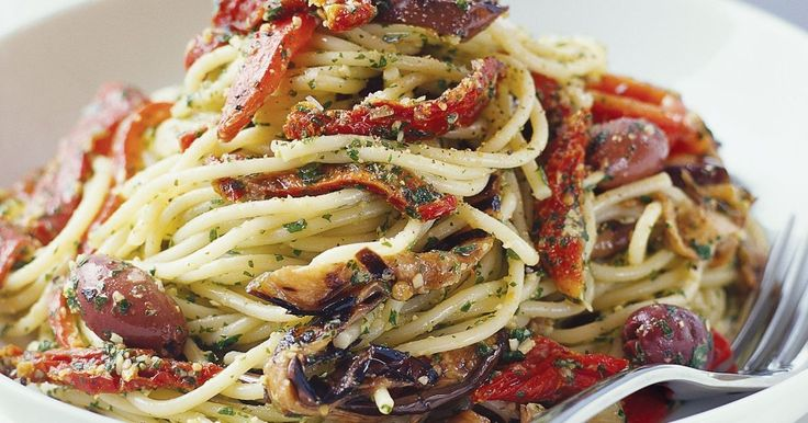Home-made basil pesto shines through in this delicious vegetable-filled pasta.