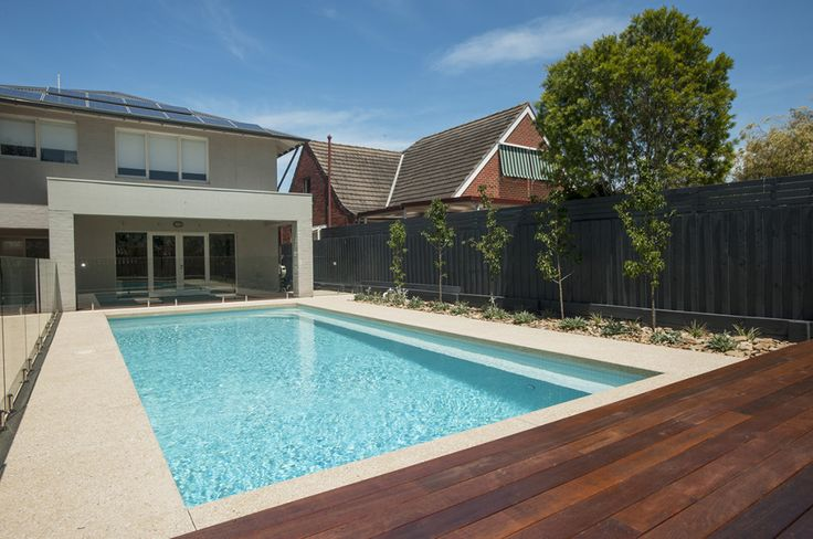 Gallery | Personal Pools Fence painted black; Fence Extensions; Pool Orientation; Sideline Screening Trees; Glass Pool Fencing; Paved surround