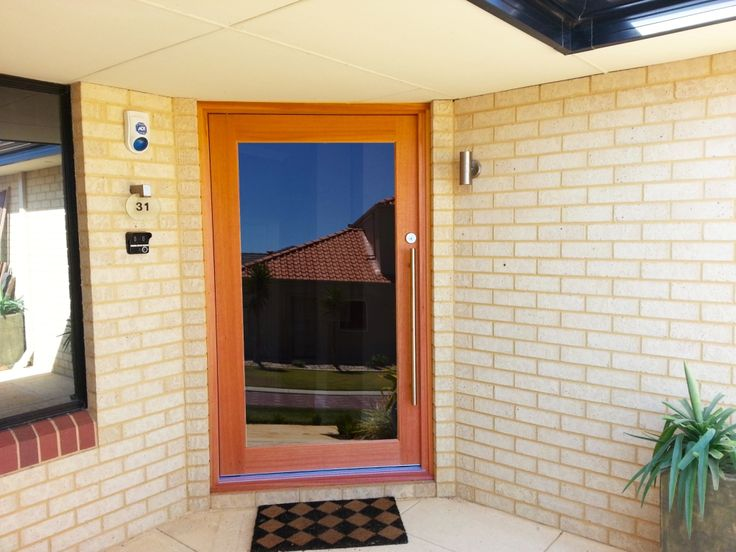 Glass and hardwood entrance pivot door in Perth