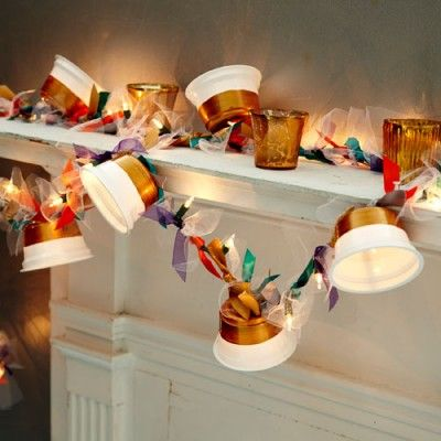 Garland/decor made of recycled yogurt cups and white lights. --Deen: Would make great use of my Chobani cup collection! I always feel bad throwing those away. If you cant recycle them, upcycle!!  :)