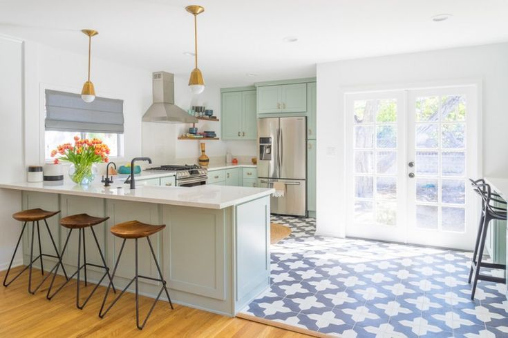 white kitchen wooden floor moroccan pattern tile tall chairs bright kitchen wall cabinets dark faucets cool lamps flowers big windows of White Kitchen Designs to Get Inspirations From