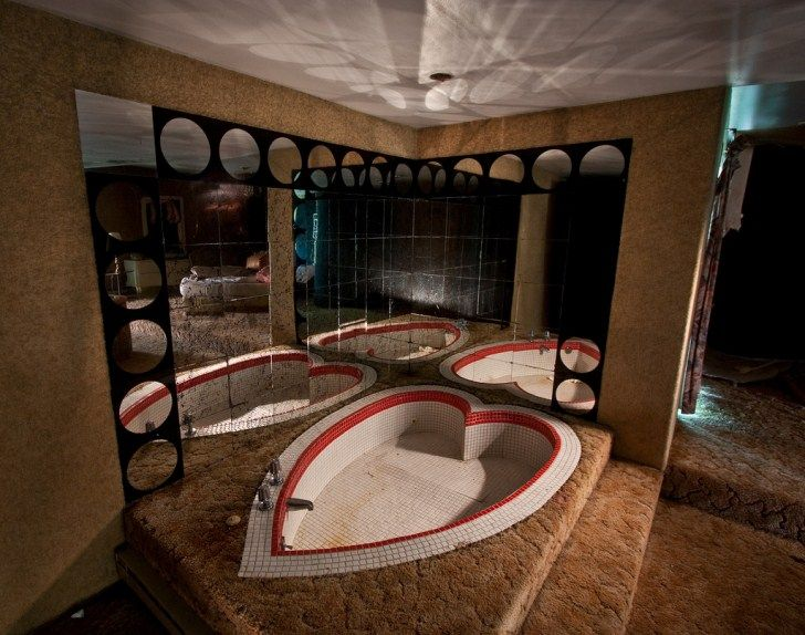 The Abandoned Penn Hills Resort in the Pocono Mountains - There is something really creepy about this picture. I don't know if it's the empty heart tub, the 1970's carpet or the reflection in the mirrored tiles.