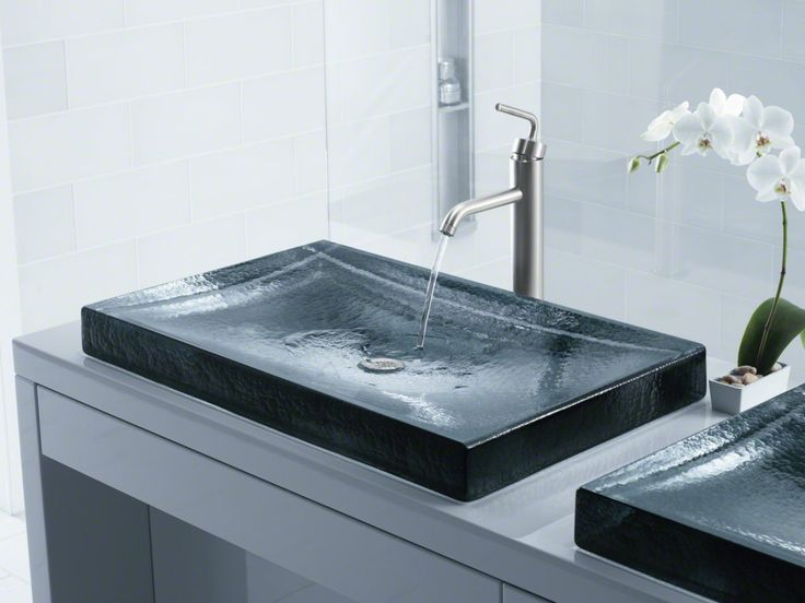 kohler antilia glass sink the subtle rippled texture of the cast glass antilia wading pool sink makes a distinctive statement in the bathroom that is as