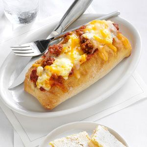 Baked Lasagna in a Bun Recipe -My family loves the meat sauce and cheese tucked into the hollowed-out buns. Add a crisp salad for a complete meal. — Cindy Morelock, Afton, Tennessee