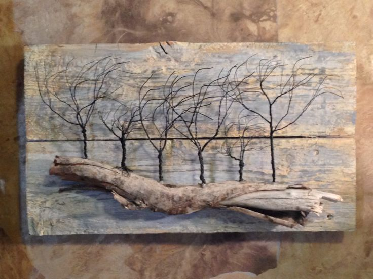 "Pinner/my friend Nancy Schrempp says, ""My favorite and most prized piece. Love how it turned out!""  I agree!! If only this pic did it justice!  It brought a good sum a an auction.  Barn wood, drift wood, wire, and a lot of imagination created this wind-blown tree wall-hanging."