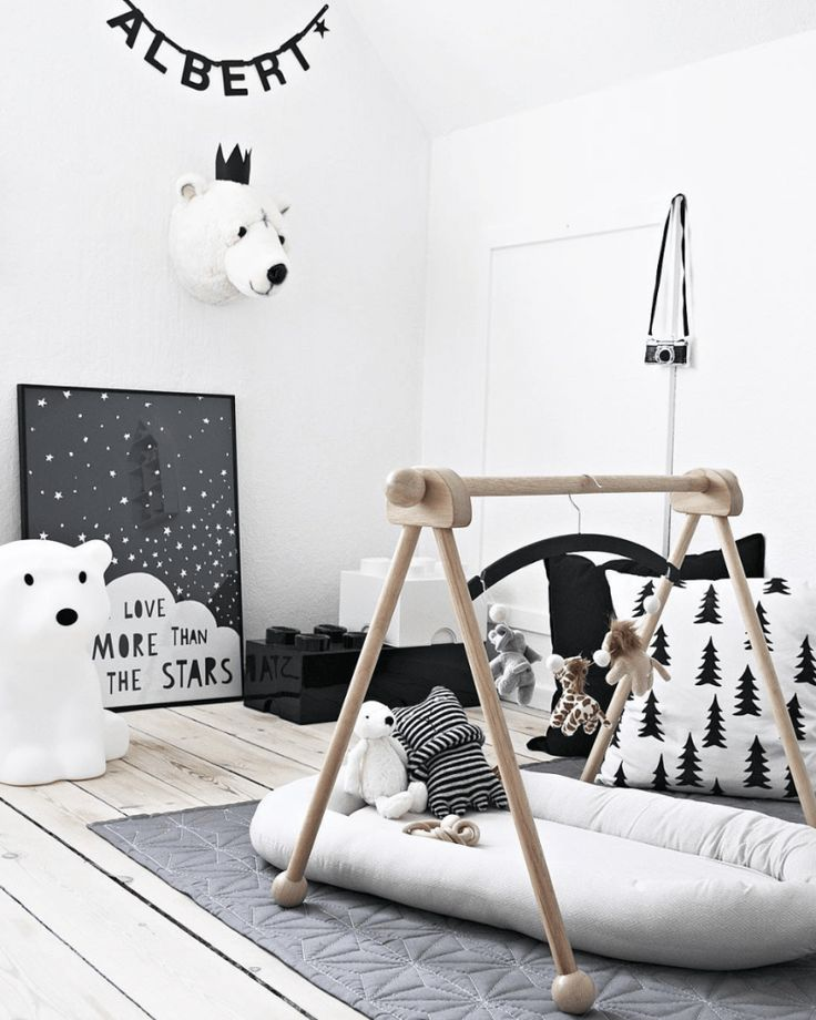Buy or DIY a wooden baby gym.