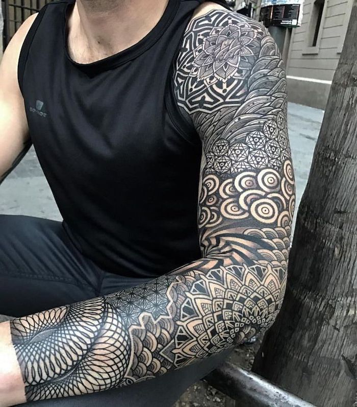 Large Black And White Arm Sleeve Tattoo Man Sitting Wearing All Black Forearm Tattoos For Men Tatuaggi Braccio Idee Per Tatuaggi Tatuaggi Geometrici