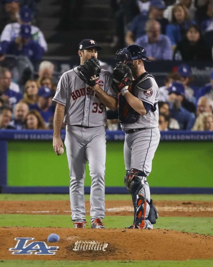 October 31, 2017:  Astros lose to Dodgers in Game 6, set up winner-take-all Game 7.   Houston Astros starting pitcher Justin Verlander (35) and catcher Brian McCann talk during the fifth inning of Game 6 of the World Series at Dodger Stadium on Tuesday, Oct. 31, 2017, in Los Angeles. Photo: Michael Ciaglo/Houston Chronicle