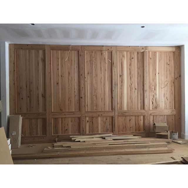 A wall of pecky cypress paneling taking shape at one of our homes under construction! #chandelierdevelopment #peckycypress #nashvilleinteriors