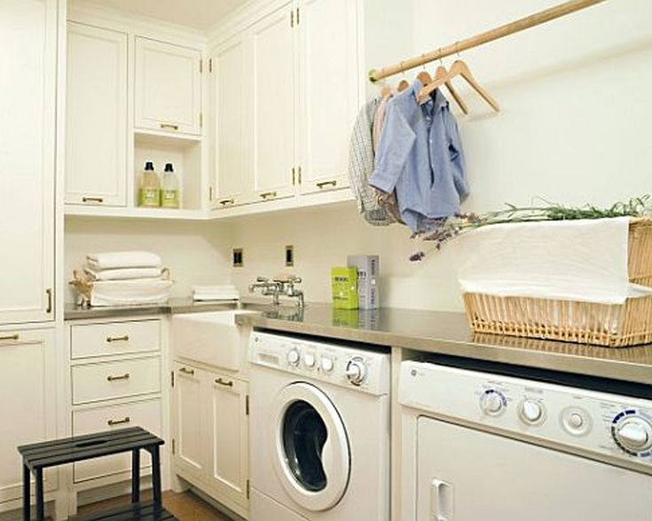 Ideal Laundry Room Designs.....Countertop Extends Over Washer And Dryer And