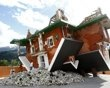 Upside down house in Austria built as a tourist attraction. The only thing missing is the wicked witch of the East. She must be hiding under all that rubble
