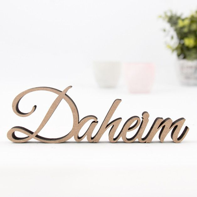 Home accessory reading 'Daheim' in a beautiful font which is German for 'Home'