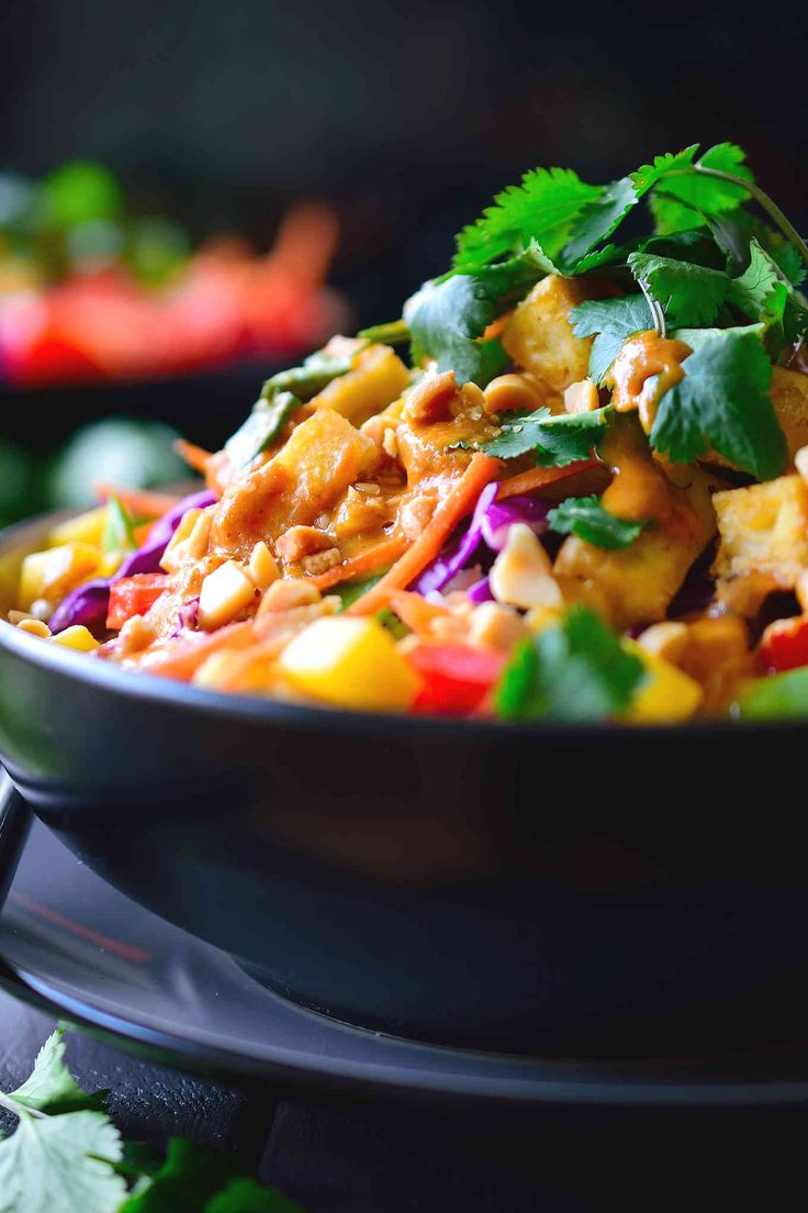 This Thai Buddha bowl costs $2.65 per serving and is quick and easy with vegetables and tofu served over coconut rice and a simple Thai peanut sauce.