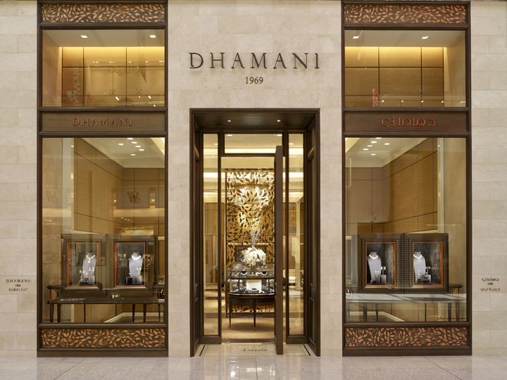 An intricate bronze-finished screen with the Dhamani brand floral pattern, reminiscent of a traditional pottery motif from Jaipur, India, is placed at the center of the boutique's entry.