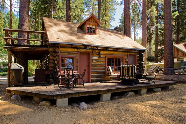 This saddle-notched log cabin was built in 1929 on Lake Tahoe. It has a 475 sq ft footprint plus a loft bedroom.
