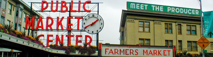 The Public Market in Seattle, WA. OHMYGOSH. Let's go there every day and buy a bouquet of flowers, fresh fruit, a cup of Starbucks coffee, and then have breakfast on the waterfront.