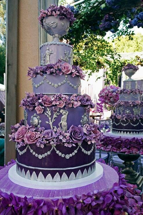 This Ornate Wedding Cake In Shades Of Purple And Silver Features Hand Made Sugar Roses Fondant Grecian Figures Cakes