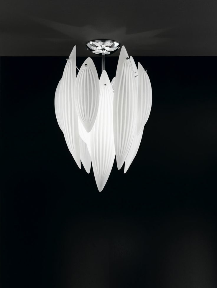 A sublime and ethereal flush ceiling lamp reminiscent of magnolia flowers just before opening. A chrome metal ceiling plate and column support glass petals in white Murano glass worked with distinctive and elegant ribs. Diameter 44cm, height 62cm.