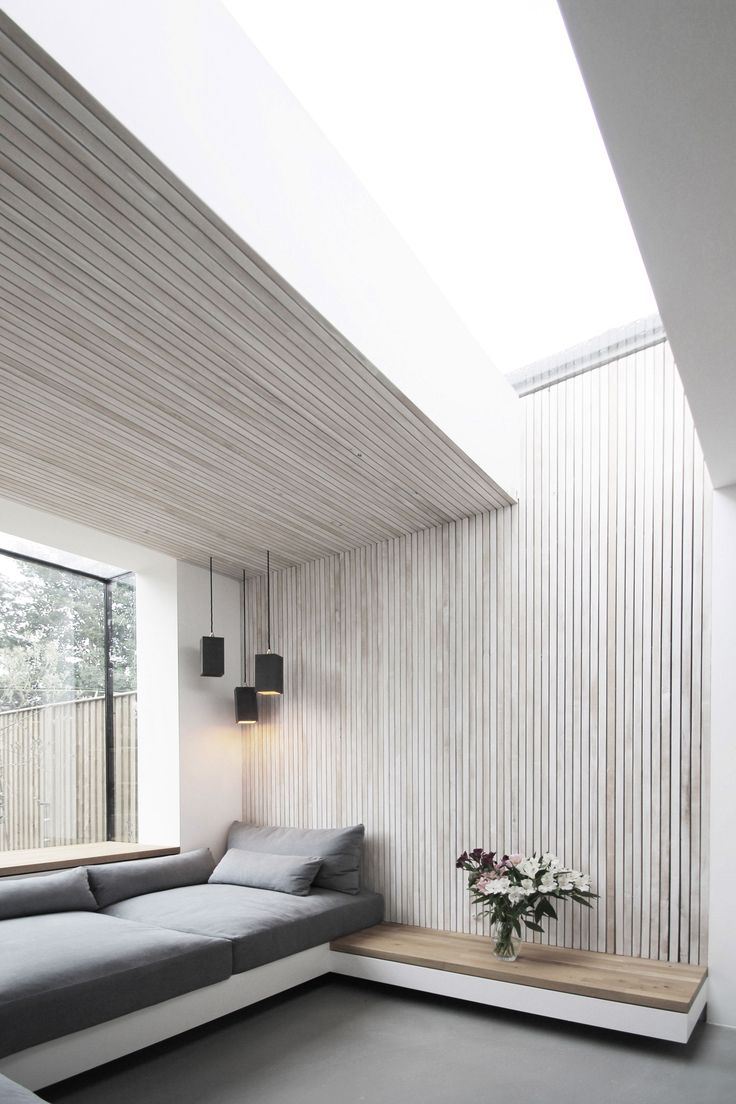 Studio 1 Architects has added a brick extension with a large window to the rear of this Victorian house in London, creating a light-filled seating area clad in white-washed ash slats.