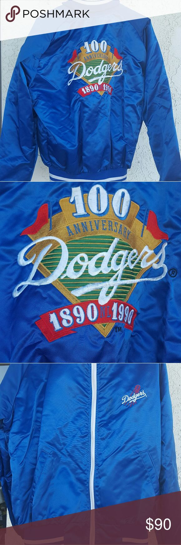 LA Dodger Vintage 90s 100 year Anniversary jacket Vintage LA Dodgers original jacket. Sz XL fits like a modern large. Some small stains seen pictured, can probably be removed withbdry cleaning. Price reflects this. Inside in good condition. Please message for more pics:) urban for exposure Urban Outfitters Jackets & Coats Bomber & Varsity