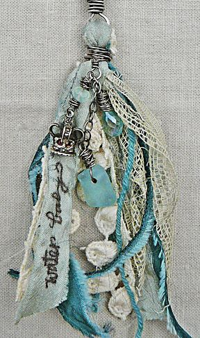 turquoise and cream vintage looking tassel with lace, beads and charms.