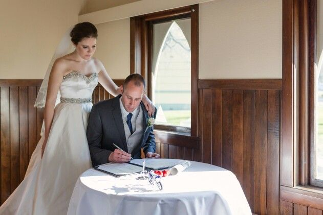 Signing the register.  | Christchurch Wedding Photographer Mandy Caldwell #wigramwedding Http://mandycaldwell.co.nz