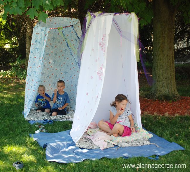 fort made from hula-hoop and shower curtain. just hook the rings on the hoop.