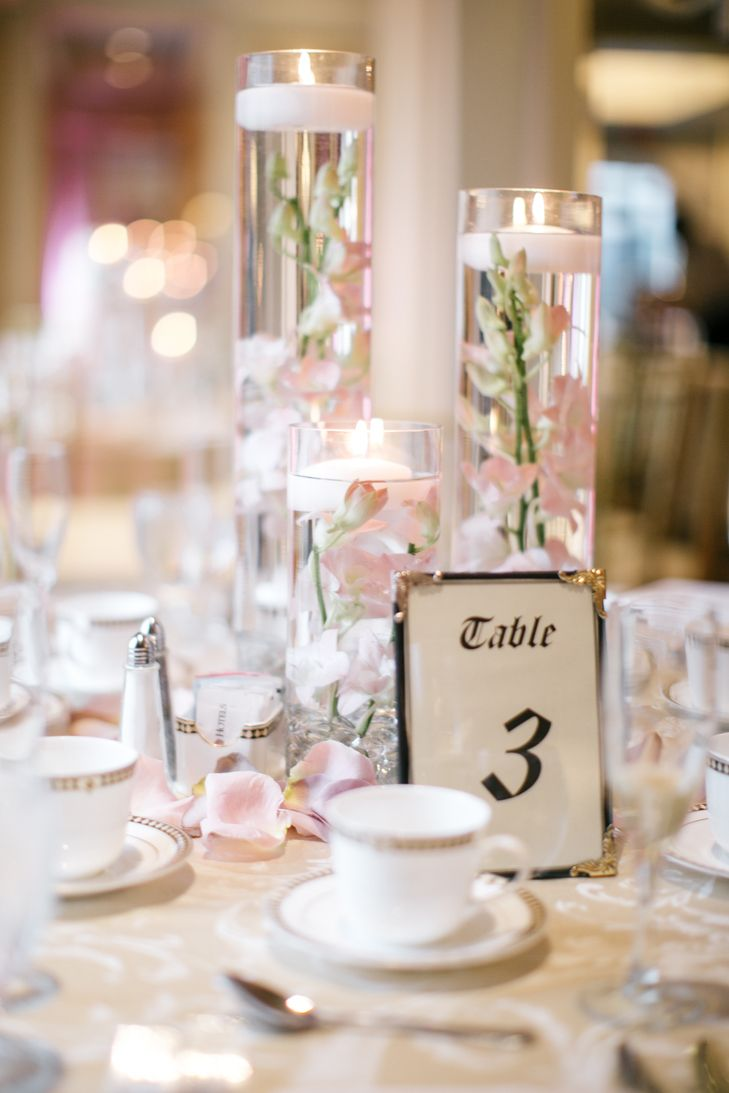 Floating candle centerpieces with blush orchids and rose