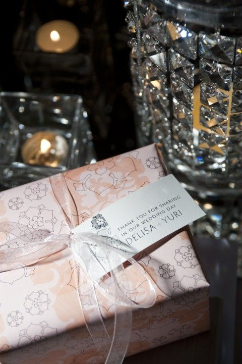 Wrapped bonbon was a gorgeous idea, give a gift that the guests anticipate opening!