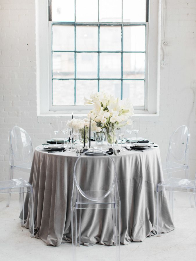 Gray linens and modern ghost chairs: http://www.stylemepretty.com/2016/12/14/masculine-elegance-wedding-ideas/ Photography: Samantha James - http://www.samanthajamesphoto.com/