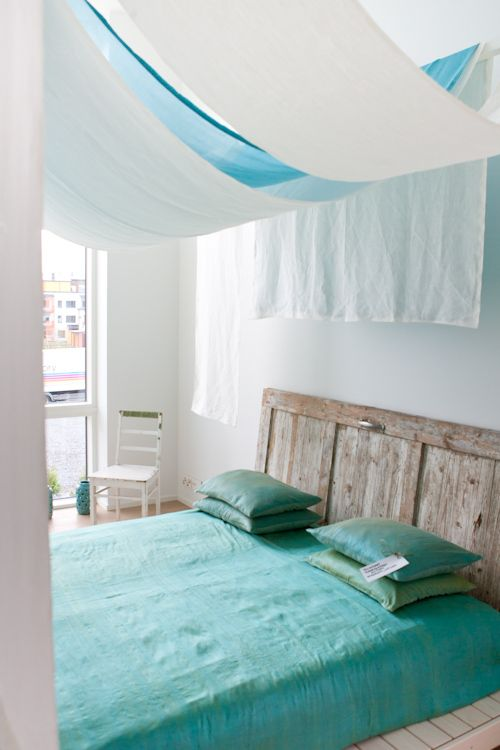 I've always wanted to drape fabric over my bedroom ceiling... saw it at a wedding once... looks cool