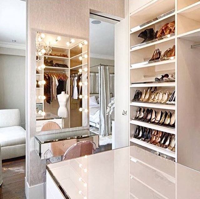 Fancy Walk In Closet With Vanity Island Cabinet And Sufficient Shoe Storage