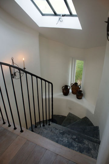 stairs with iron rail and skylight
