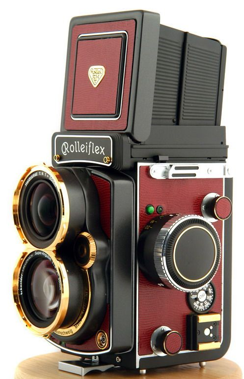 Rolleiflex 2.8FW TLR Medium-format camera with 50mm Super Angulon 4.0 HFT lens in 24K Gold in red skin.