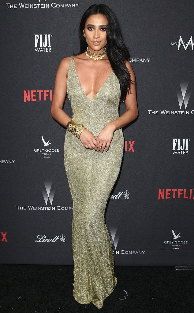 Shay Mitchell from Golden Globes 2017 Party Pics  The Pretty Little Liars star opted for a metallic v-neck gown and statement jewelry for the Weinstein Company and Netflix after-party.