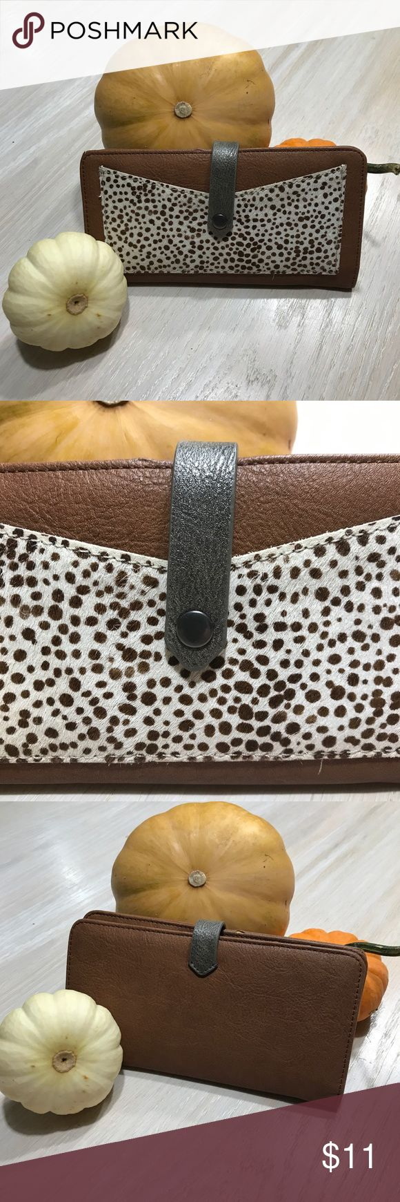 "Abercrombie and Fitch wallet snap clasp & faux fur Abercrombie and Fitch wallet in a checkbook style. Has a metallic silver strap clasp, outer and inner pockets. Vegan leather and cotton poly blend lining. Outer cow print pocket has faux fur! Small nick on top edge by clasp (see photos).  SPECS: 7 1/4"" wide 4 1/8"" tall (closed) 7 7/8"" tall (opened) 5 card pockets 3 long pockets 1 outer pocket (cow print)  WEAR IT: 💳as a clutch; all your essentials with no bulk 👜use it in a purse for your…"